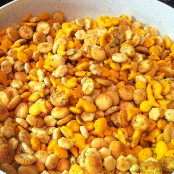 Cracker Mix  2 packages of oyster crackers  2 packages of goldfish  2 packages of Ranch dressing mix  1 1/2 cups of oil  2 tsp of dill weed  2 tsp of garlic salt  2 tsp of lemon pepper    Mix the oil, lemon pepper, garlic salt, and dill were in separate bowl. Pour over crackers, stir with wooden spoon. Add the Ranch mix. Stir very very well.