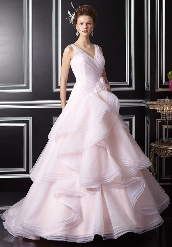 Gown features beaded lace flowers and tiered skirt.