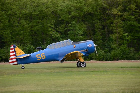 North American T6 F-HLEA, trainer, on the airshow circuit in France & Europe, at La Ferté Alais.
