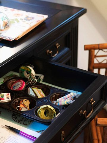 Mini Compartments.   This pan will do more than help you cook when you use it to compartmentalize office supplies. Use an inexpensive cupcake pan to organize small items that have a tendency to get lost in drawers.