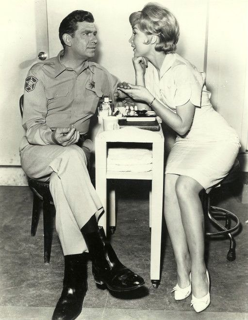 Andy Griffith gets a manicure from Barbara Eden. A classic.