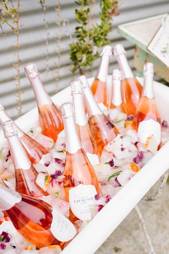 Rose + flower ice cubes for days: http://www.stylemepretty.com/living/2016/05/09/the-prettiest-way-to-give-back-this-floral-and-bubbly-party/   Photography: Jodee Debes