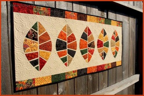 Gorgeous autumn quilt art.  http://patternpile.com/quilt-patterns/wp-content/uploads/Fallen-Leaves-Quilted-Table-Runner-Pattern.jpg