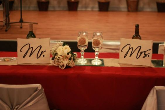 Bridal table at wedding.  Flash bleached but maroon tablecloth with silver chair covers.  Aggie wedding.