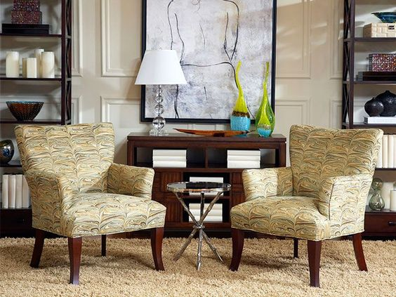 A pair of these curved wing arms Ethen chairs will upgrade your style in any room with its rich wood flared legs and unique fabric design. | Ethen Chairs cort.com