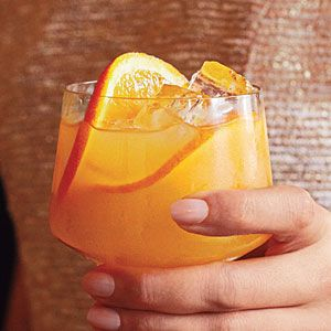 Whiskey Sour Punch Recipe - 1/3 cup sugar   1/3 cup water  2 1/2 cups refrigerated fresh orange juice   2 cups bourbon  1/2 cup fresh lemon juice (about 3 large lemons)  3 cups chilled club soda   Fresh orange slices (optional