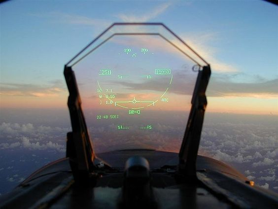 Head Up Display (HUD) view from FA-18 Hornet. Symbology clockwise from top: Aircraft heading 194 degrees true; Altitude 19,950 feet Mean Sea Level; Pitch Angle zero; Auto Throttle Control (ATC) engaged; AIM-120 AMRAAM Bravo selected, 0 loaded and Master Arm unarmed (x