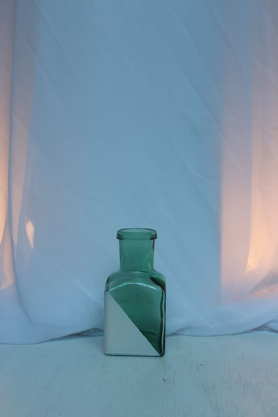 green glass square bottle with corner painted white