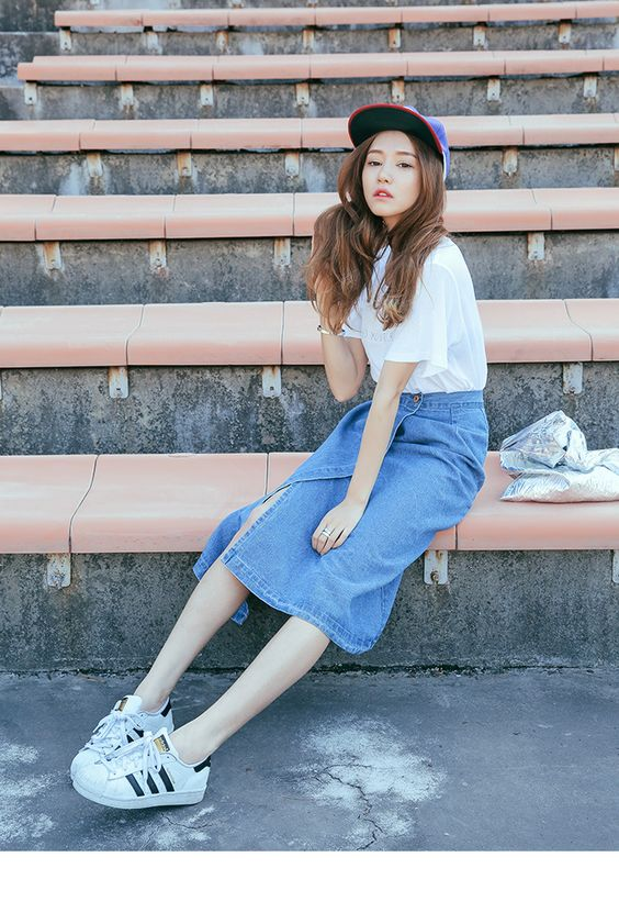 Denim Wrap Midi Skirt|Electrify your spring outfit with this denim skirt. In a mid length, it has a wrap front and a back slit. Moreover, its dark blue color will go with every color. Wear with ankle strap sandals.|stylenanda: