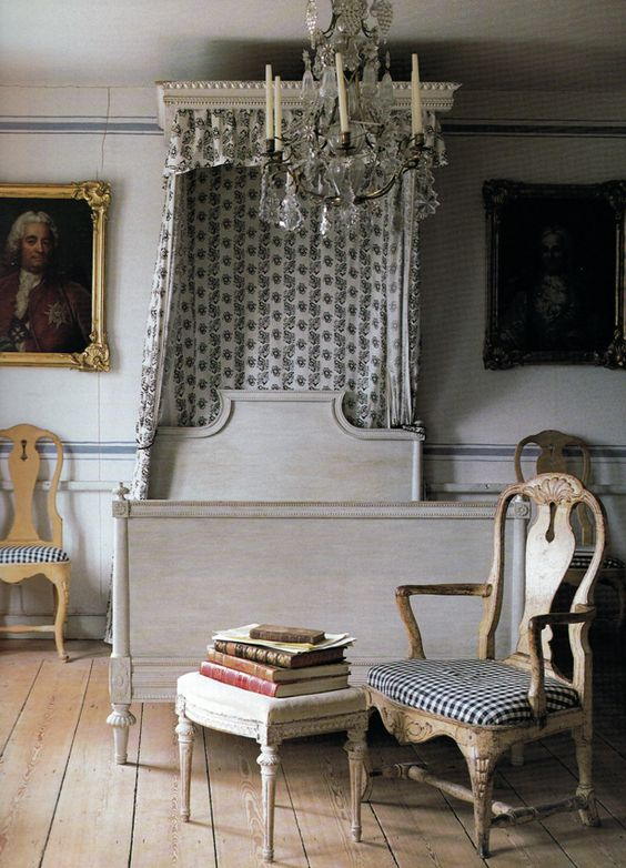 Lars Sjoberg's house gorgeous canopy bed and chandelier. I love the grain sack stripe painted on to the walls!