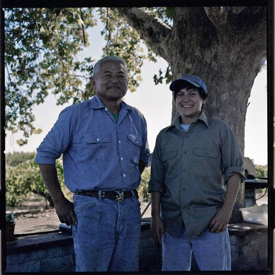 Nikiko Masumoto is a Califas artist, who is organizing Passages / Home: A Central Valley Art Bus Tour on October 19th. In photo: Nikiko Masumoto & Friend. Photo taken by Joan Osato.