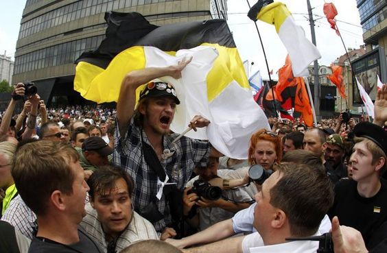 Russian nationalists march through the crowd during an anti-government protest in Moscow June 12, 2012.