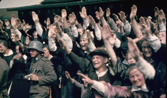 Happy Austrian crowds saluting at Schwarzach-St. Veith during Hitler's Austrian election campaign, 1938