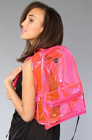 "Translucent vinyl backpack with logo plaque detail; exterior zip pocket; zippered main closure; padded adjustable shoulder straps; faux leather trim.    Measures 12"" W x 18"" H x 6"" D    By Joyrich"