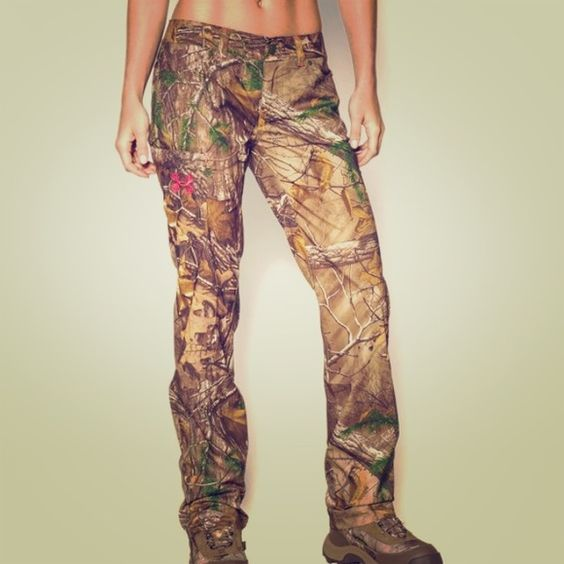 UA Field Performance Hunting Pants NWT.  Women's size 12.  Inseam: 32.5 inches Semi-fitted: a slimmer, athletic cut. Ultra durable rip stop construction is lightweight and heavy duty. Quick-Dry for moisture wicking. Officially licensed through Mossy Oak™ by Under Armour. Women's hunting pants. Under Armour Pants