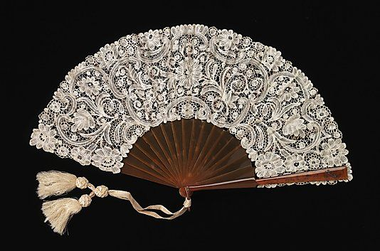 Fan  Attributed to Mor Weisz  (Austrian)  Date: 1890–1910  (probably)   resin, metal, linen, silk, paper Dimensions: 11 in. (27.9 cm) Brooklyn Museum Costume Collection at The Metropolitan Museum of Art