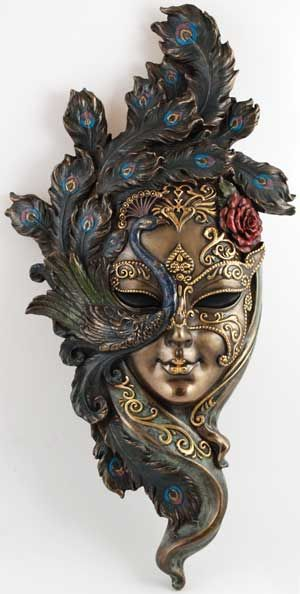 Ornate decorative Venetian mask surrounded by a peacock! Gorgeous! A definite want for me.: