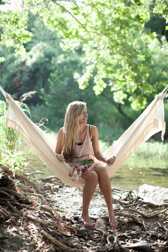 Make a Hammock Transform a bolt of muslin into a pretty hammock to enjoy the lazy days of summer in. From Camille Styles.