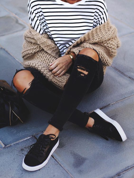 chunky knit cardigan, striped top, ripped skinnies, black sneakers street style: