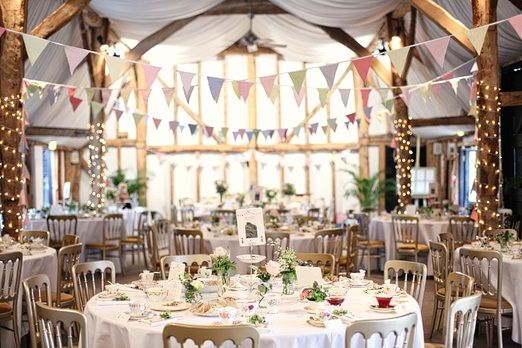 Beautiful vintage-inspired, country, chic wedding- beautiful pastel color scheme, twinkle lights and rustic venue. Great for spring!