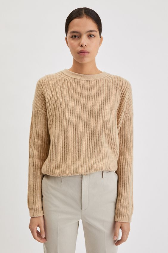 A closet staple, this relaxed, long-length cashmere sweater features a dropped shoulder. The shoulder seam is positioned slightly further back, adding to the effortless appearance. Elevate everyday denim on cooler days with this piece, or layer it over a relaxed collared shirt.