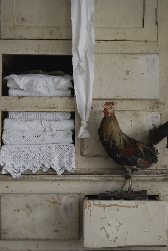 French linens in an vintage cabinet and a chicken:)