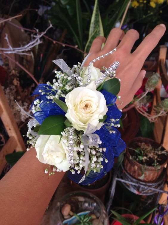 Indigo transparent ribbon with white roses, baby's breathe and silver details wrist PROM corsage by Mariam's Flowers.