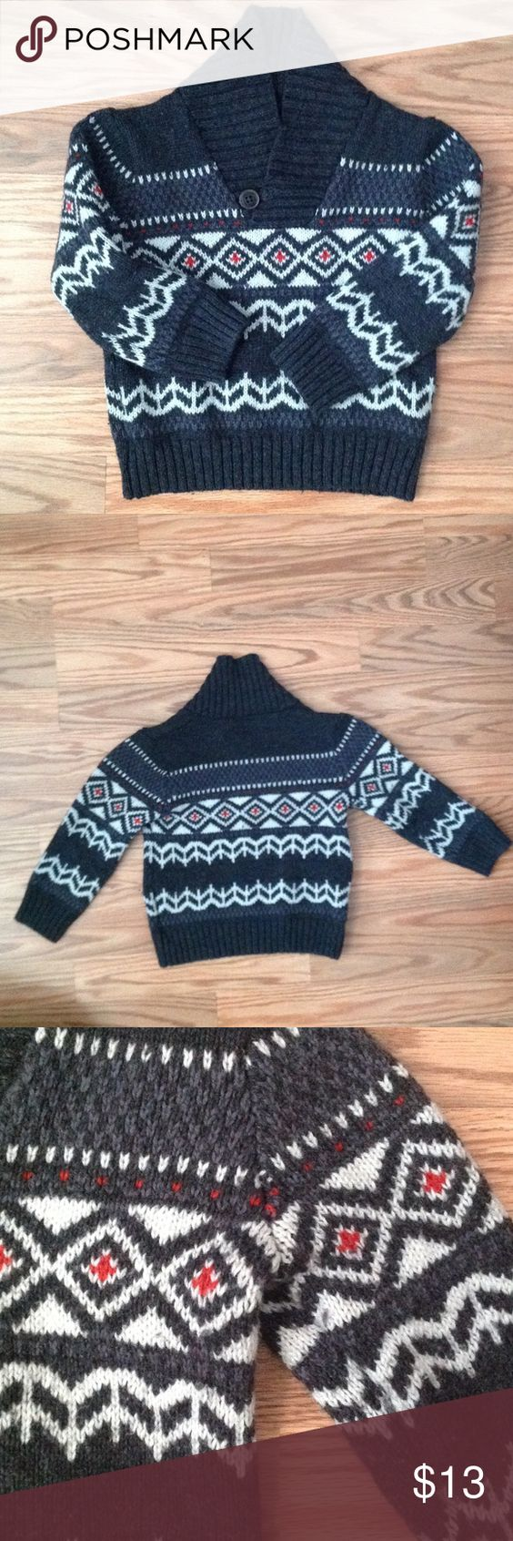 Fair Isle sweater 2T Toddler EUC Osh Kosh Fair Isle sweater with notch button collar. Excellent used condition. Dark grey with red and white accents. Perfect for the holidays. Size 2T. Slight pilling, but not really noticeable overall. Osh Kosh Shirts & Tops Sweaters