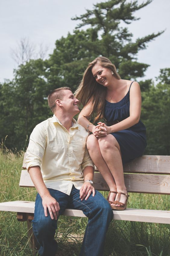 Engagement portraits.  Casual use a bench in a beautiful wooded setting.  www.greenseedphotography.com