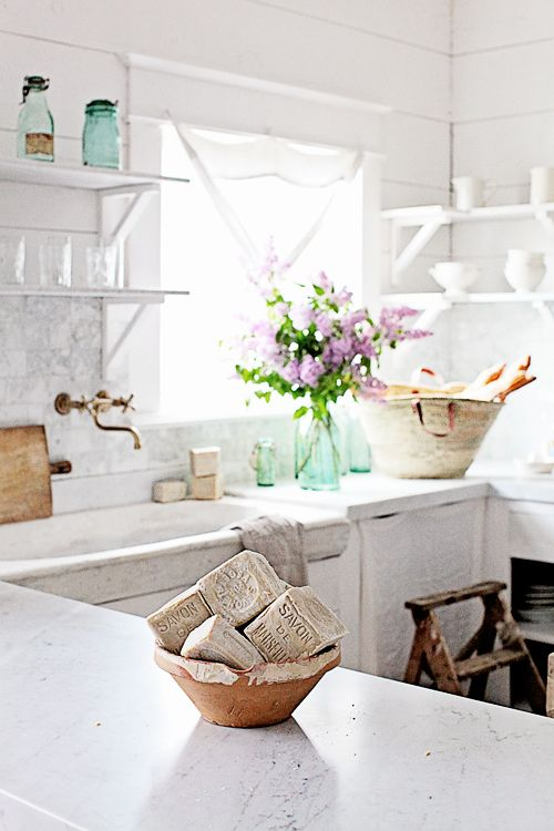 French soap on white marble counters in #Frenchfarmhouse kitchen with rustic elegnce by #Dreamywhites
