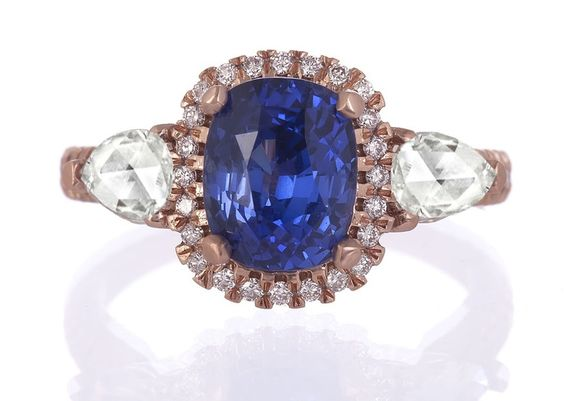 My actual engagement ring, designed by CIMELIO JEWELRY! It is beyond gorgeous, a truly special and unique heirloom (or will be, in a few years!)  A 3.18ct unheated Ceyloni sapphire surrounded by a halo of round brilliant cut diamonds and flanked by 0.50cts of pear shape rose-cut diamonds in 14kt rose gold.