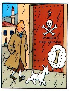 危険なマークの扉の前を歩くタンタンの画像