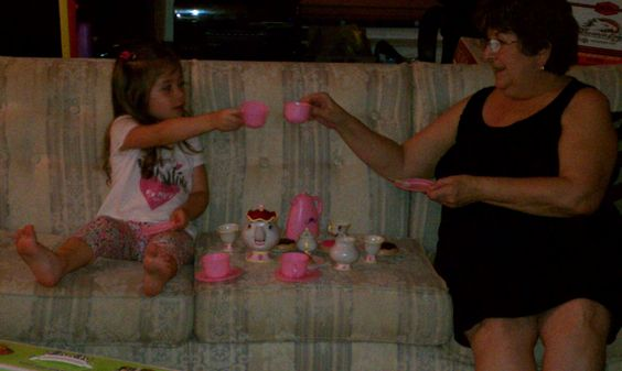 This is actually a picture of my mother having a tea party with my daughter.  It is a beautiful illustration of what makes her so wonderful.  There is no way I could put into words why I love her.  She taught us respect and love and trust by example.  She knew when to hold us close and when to step back and let us have our space.  She always believed in us, even when we were having a hard time believing in ourselves.  And she never turned down an invitation to a tea party.