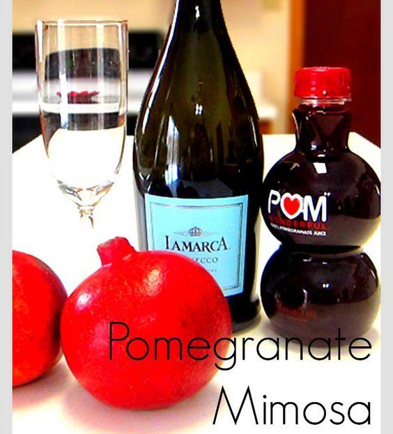 POMEGRANATE MIMOSA- Pama liqueur , champagne & top w/ Orange juice