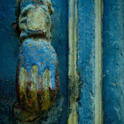 Beautiful blues and greens - detail of iron latch on one of our antique doors.