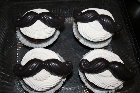 chocolate mustaches on a whipped vanilla bean frosting