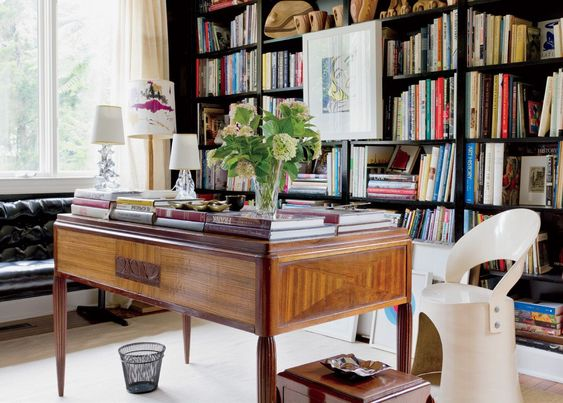 Eclectic Cream Library with Brass Sculpture | LuxeSource | Luxe Magazine - The Luxury Home Redefined