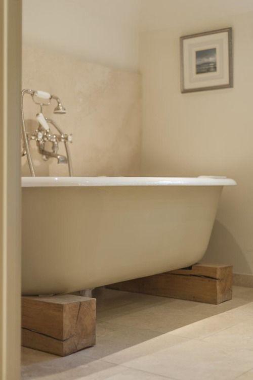 Free standing roll top bath set on oak plinths. | Orcas Bathroom ...