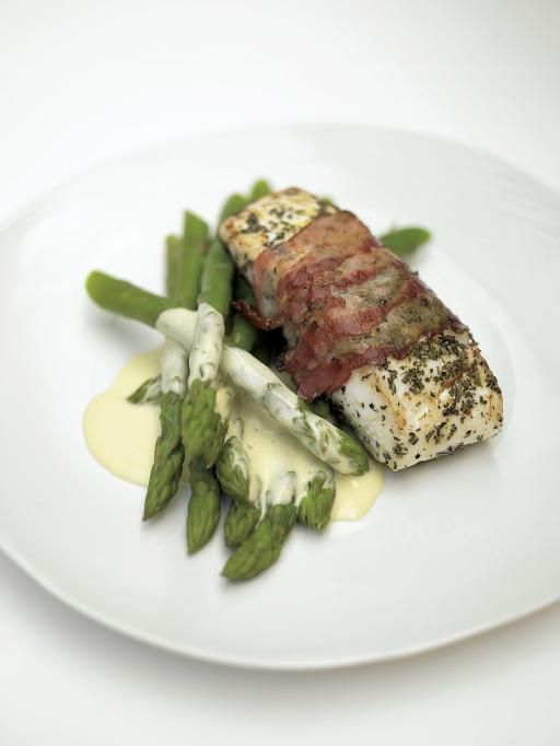Delicious roasted white fish wrapped in smoked bacon with for Fish and asparagus