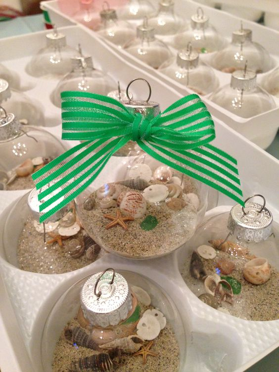Making beachy glass ornaments for a Christmas in July themed Birthday Party!  Filled with sand, sea shells, beach glass and glitter