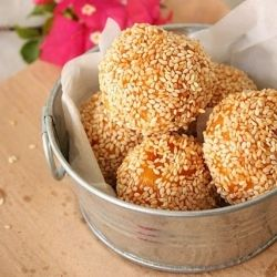 Chewy sweet potato balls with a sweet juicy coconut filling.