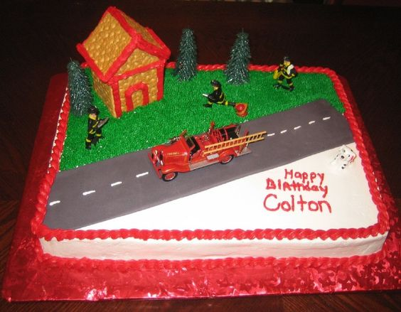 This cake is bc icing with fondant road and graham cracker house.