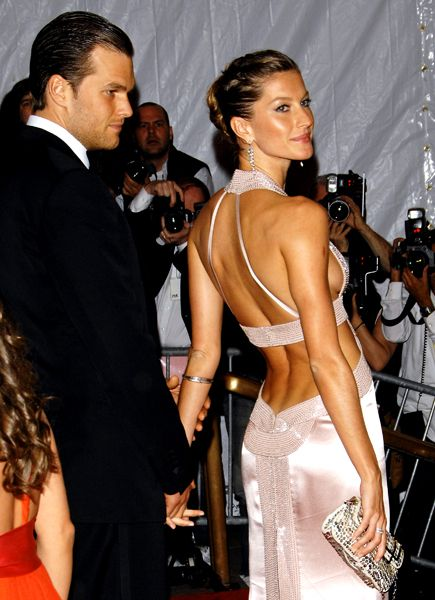 Supermodel Gisele Bündchen perfects red carpet glamour with a sexy backless dress and husband Tom Brady in tow. #giselegance