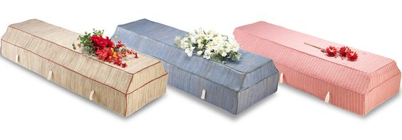 Environ cardboard coffins with fabric covers, available in a range of colours