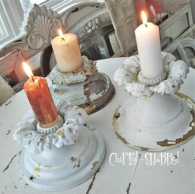 old light fixtures used as candle holders....