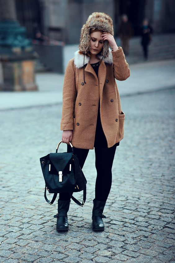 A great posing by Christina Key in streets of Berlin in winter wearing a warm coat