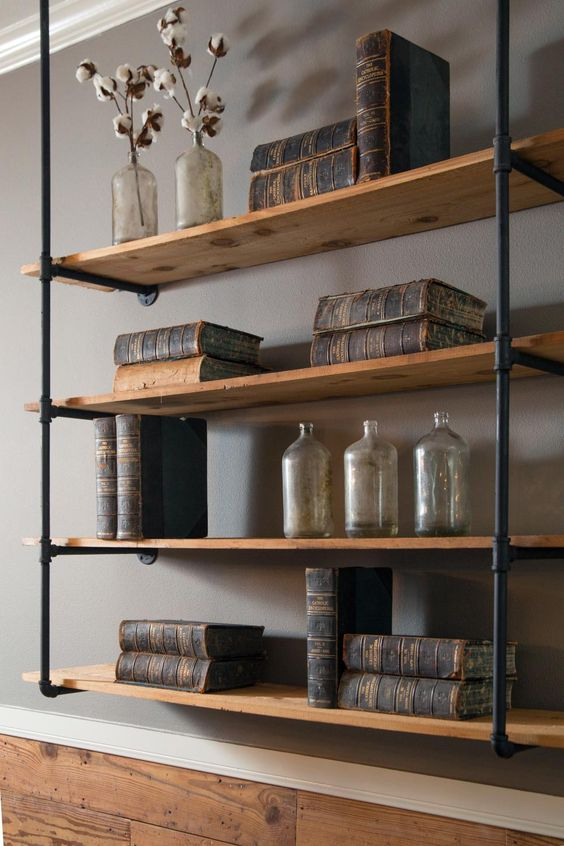 Do you secretly long for a wall of custom built-ins, knowing that your landlord would recoil at the thought? These industrial shelves from Fixer Upper  offer plenty of shelf space and can be attached with just a few screws.:
