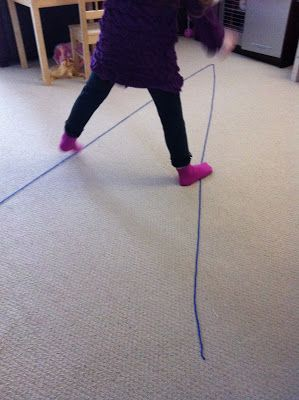 """gross motor activity - walk the """"V"""" shaped line, can do on all fours too"""