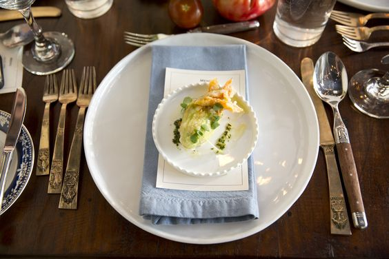 Fried Zucchini Blossom Amuse Bouche.  Mis-matched placesetting. Amazing photos by @Josh Strauss Studios from our pop up dinner on July 22. Southern Italian Food and Ambiance. Yum!