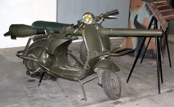 """The Vespa 150 TAP-- for use w/ paratroops, introduced 1956, updated 1959; produced in France.  Modifications incl. a reinforced frame & a mounted US-made 3"""" M20 75mm recoilless light anti-armour cannon that could penetrate 100mm of armour by HEAT warhead.  The canon was removed from the Vespa & mounted on a tripod for firing."""